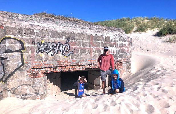 family in front of bunker