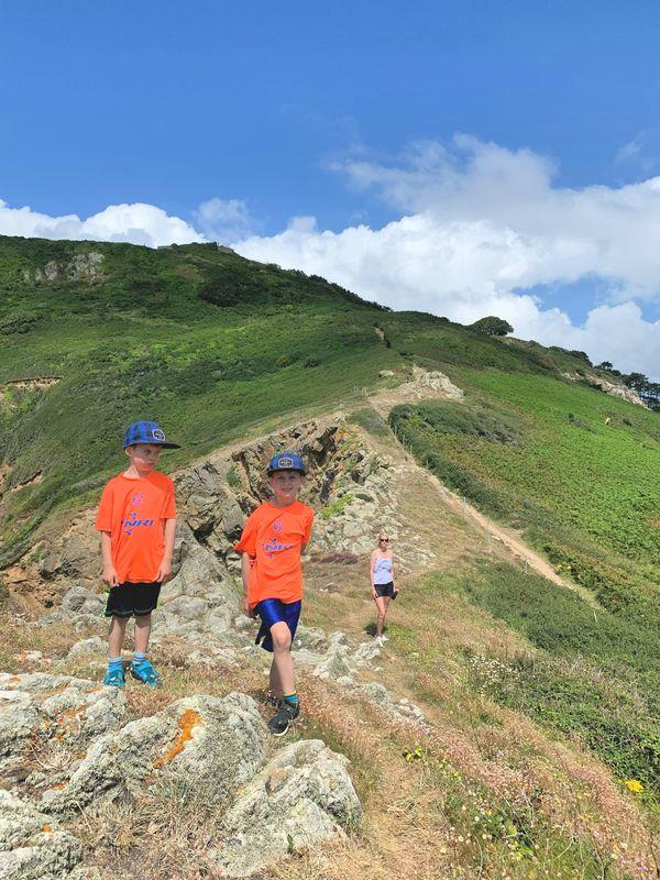 family hiking on guernsey