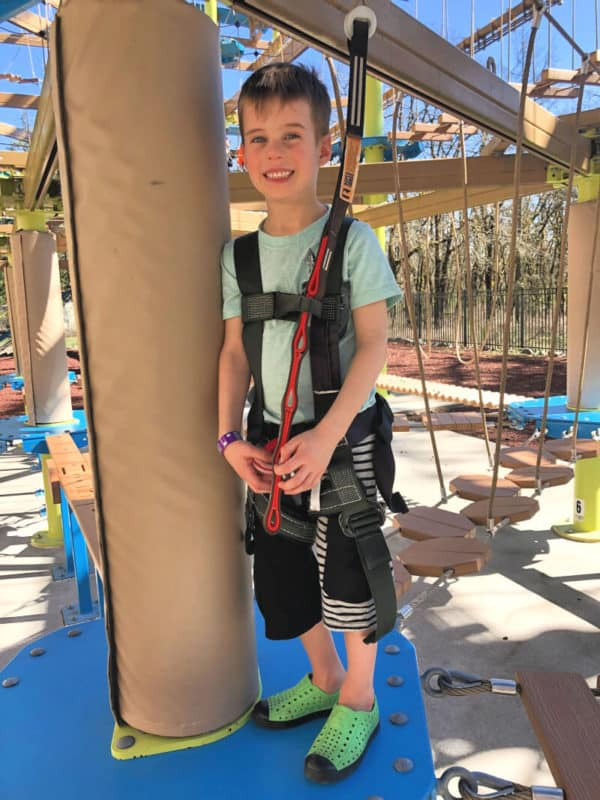 boy at suspended rope course