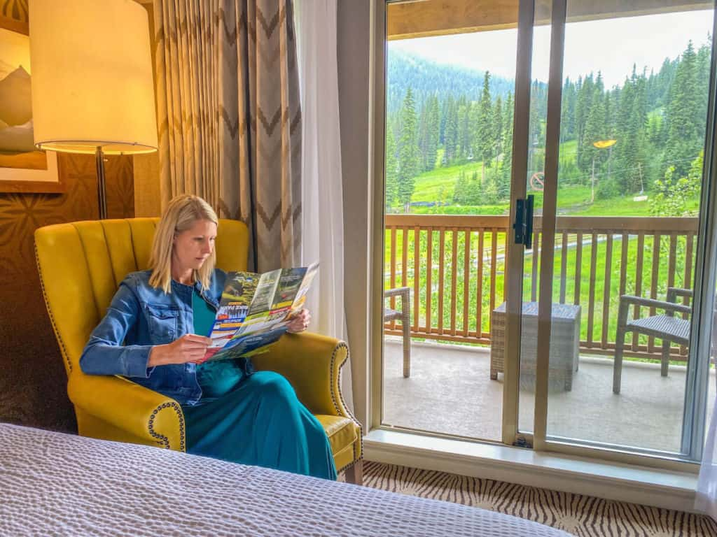 Reading in our deluxe guest room at the Sun Peaks Grand Hotel