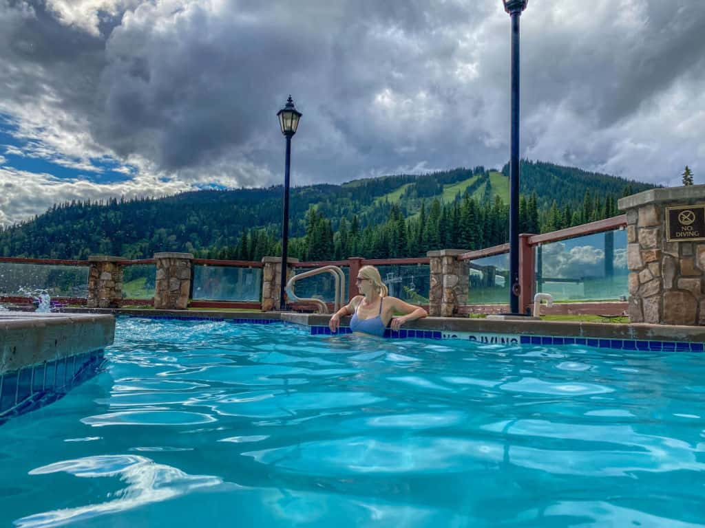 Enjoy pool time with an incredible view of the mountains at Sun Peaks Grand Hotel