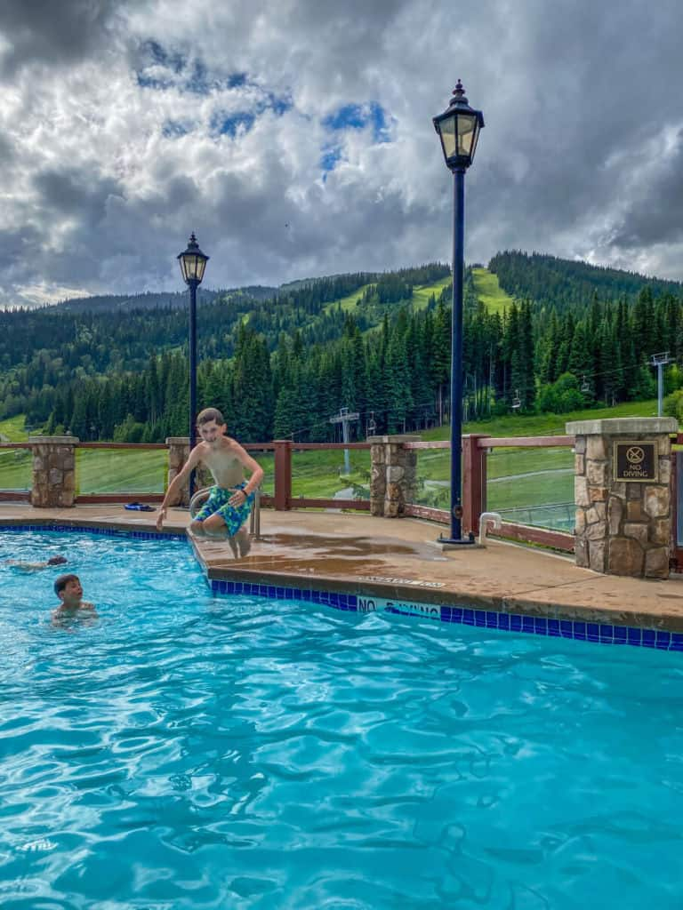 Jumping in the pool at Sun Peaks Grand Hotel