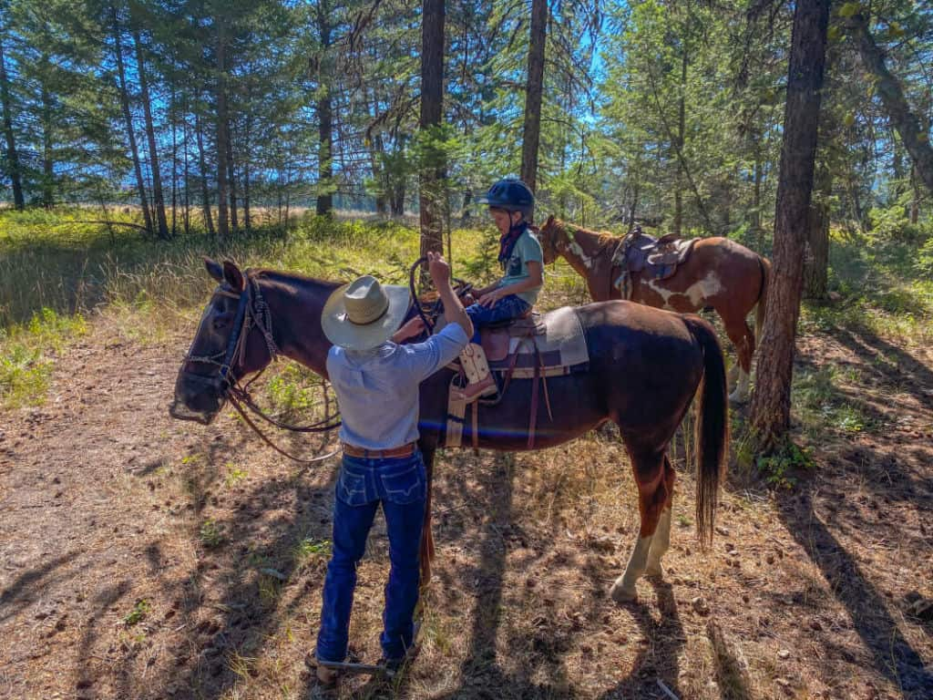 wrangler and boy on horse at this dude ranch bc