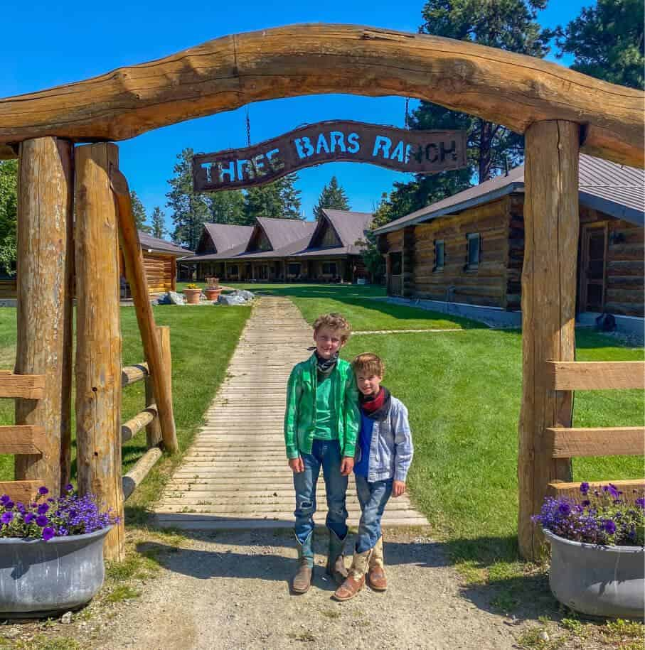 the entrance to three bars guest ranch