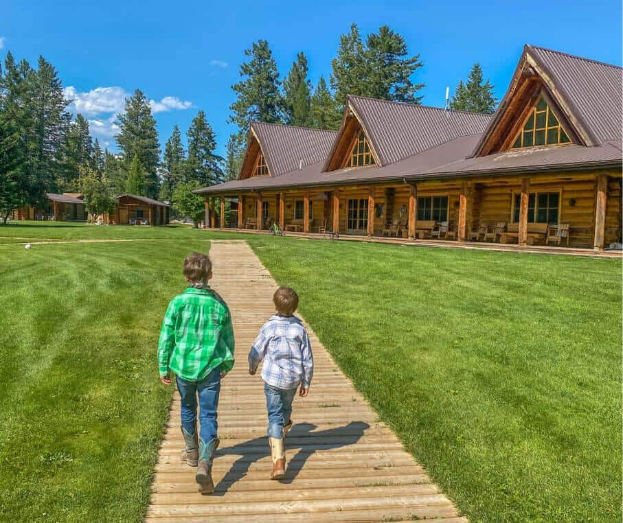 two boys walking on a ranch