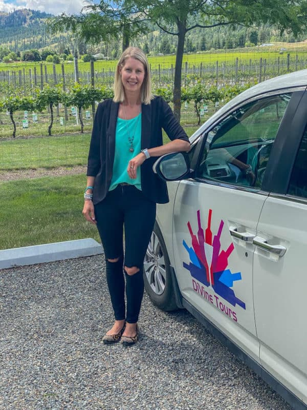 woman next to Kamloops wine tours shuttle