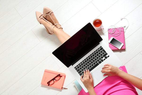 woman sitting with travel laptop