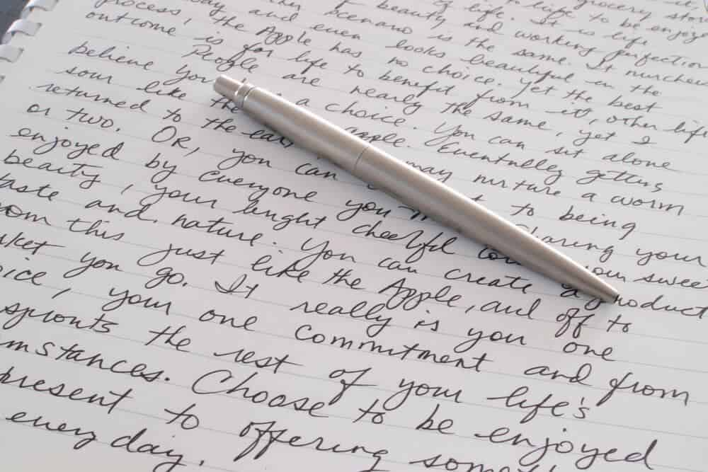 writing on paper with pen