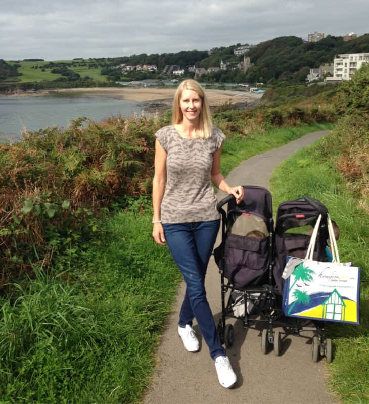woman with stroller on path