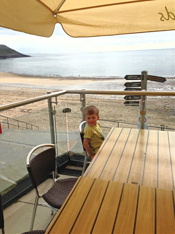 boy at restaurant patio in wales
