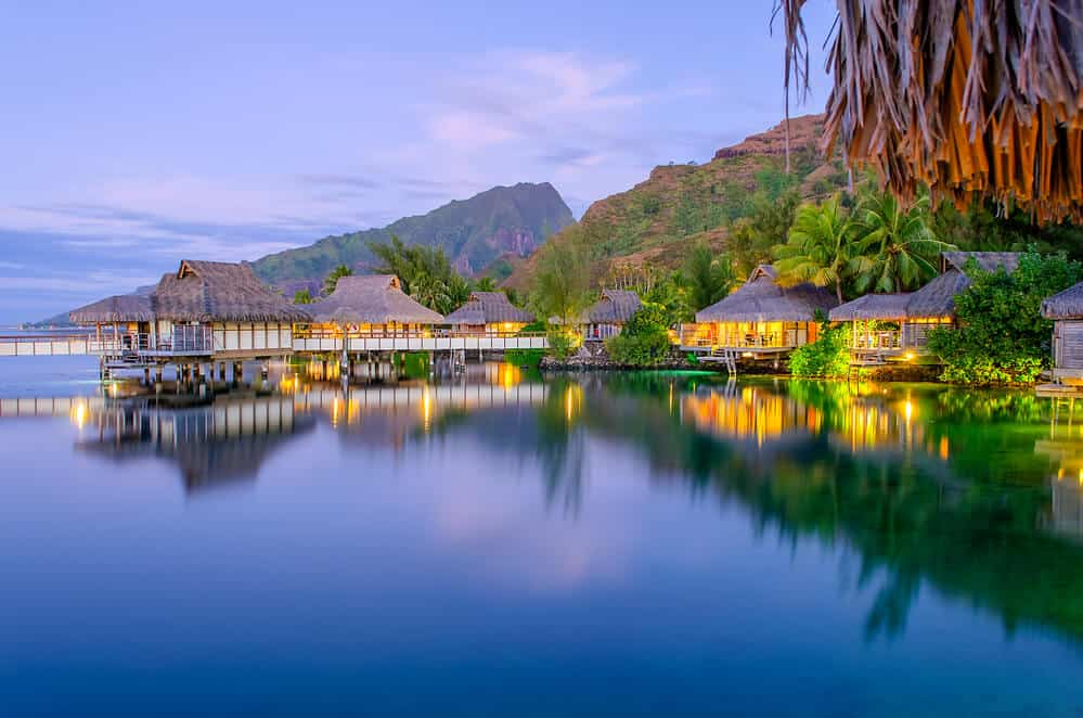 evening view of overwater bungalows