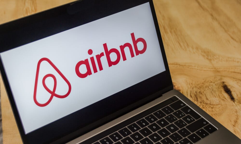 computer with airbnb logo