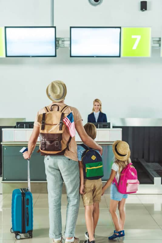 family checking into airport